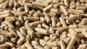 How does pelleting affect specific feed additives?